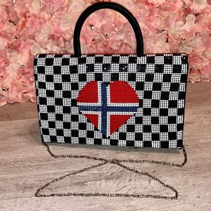 Laila The Essence of Normandy checkered heart bag